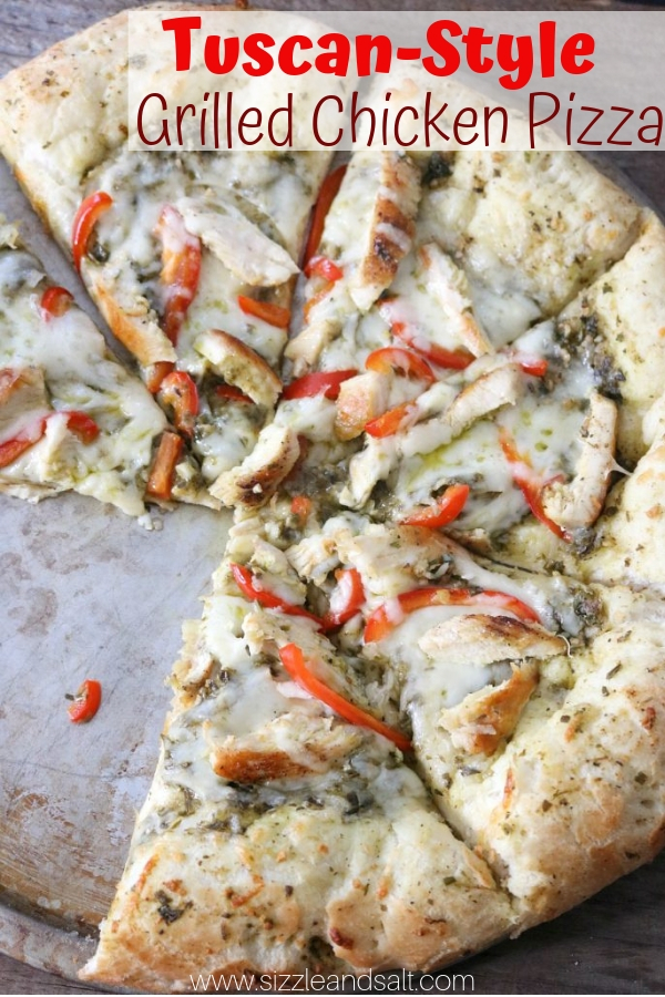 Pesto on pizza? This Tuscan-style Grilled Chicken Pizza will make a believer out of you! A fun and unique pizza recipe for family night