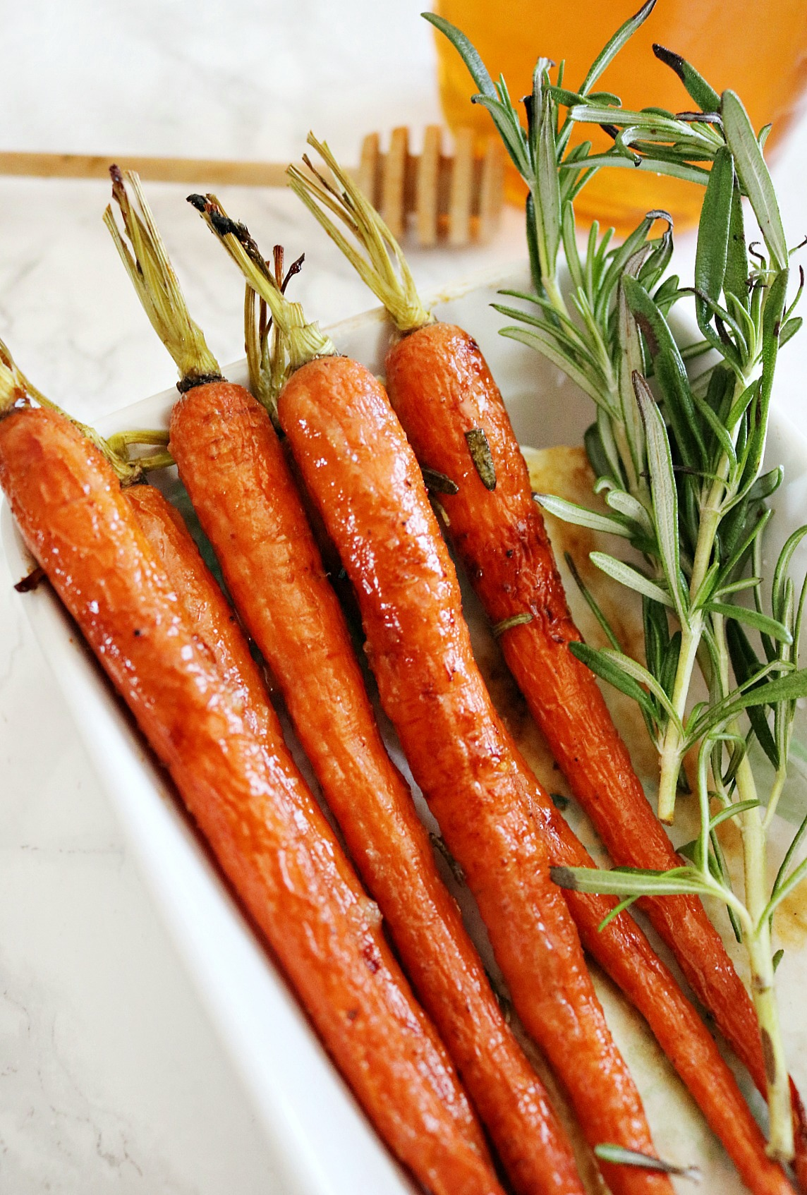 If you're trying to get your kids to eat more vegetables, this Honey Glazed Carrots recipe is going to be a game changer!