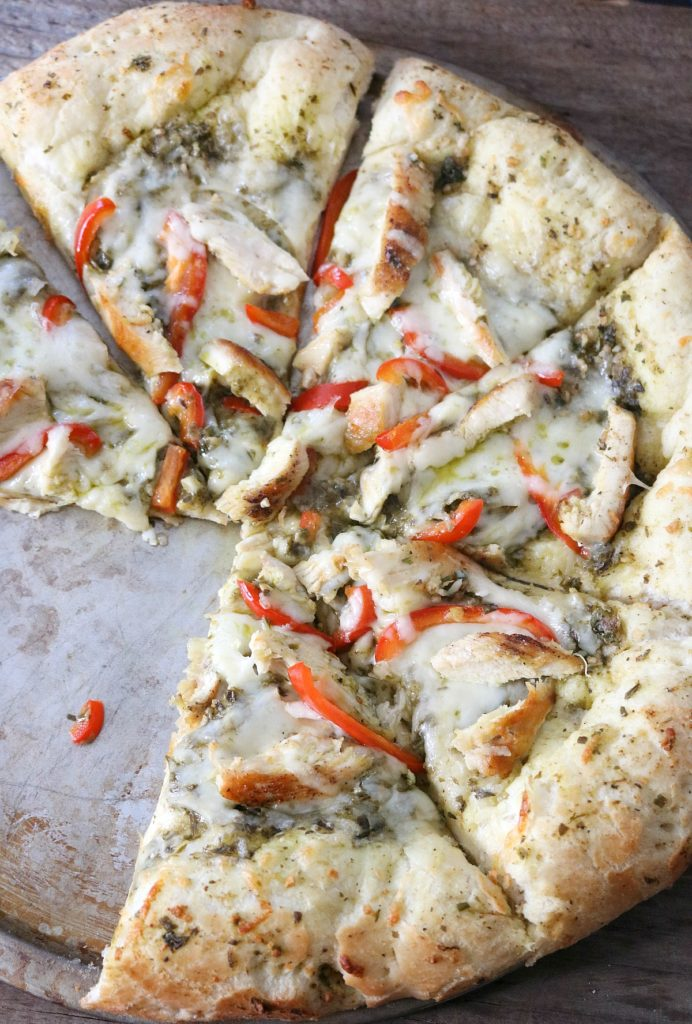 This Grilled Chicken pizza is such a fun recipe for a family movie night - pesto, mozzarella, grilled chicken and sweet bell peppers